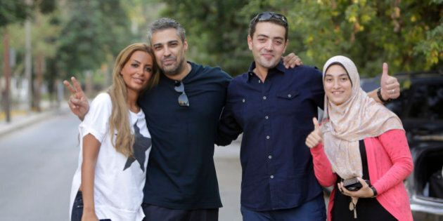 Canadian Al-Jazeera English journalist Mohamed Fahmy second left, and his Egyptian colleague Baher Mohammed,...