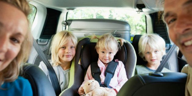 Family in car, smiling at