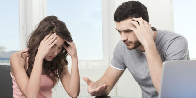 Couple, Man angry and upset after looking at credit card