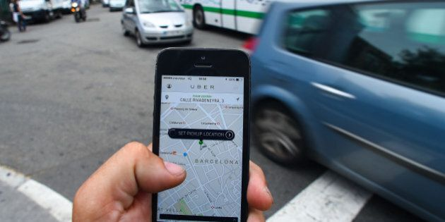 BARCELONA, SPAIN - JULY 01: In this photo illustration the new smart phone taxi app 'Uber' shows how...
