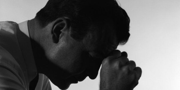 1950s SOLITARY ANONYMOUS DEPRESSED SAD WORRIED SILHOUETTED MAN HEAD DOWN HAND TO FOREHEAD (Photo by H....