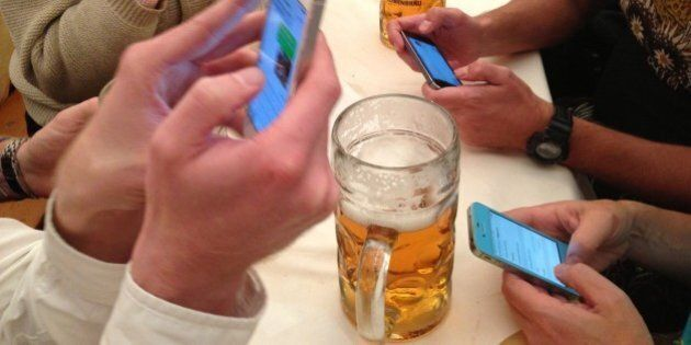 Oktoberfest Bavaria Germany Smartphone Communication and Stein of Beer as a Group of