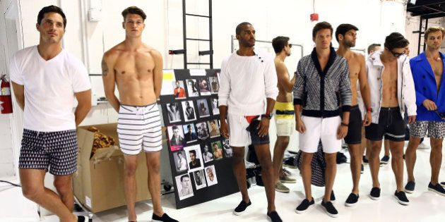 NEW YORK, NY - JULY 15: Models prepare backstage at Nautica - Presentation - New York Fashion Week: Men's...