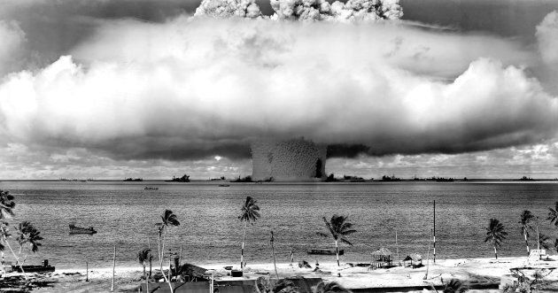 United States detonating an atomic bomb at Bikini Atoll in Micronesia for the first underwater test of...