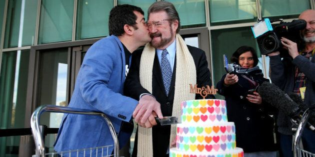 Labor Senator Sam Dastyari gives a kiss to Senator Derryn Hinch over a marriage equality themed