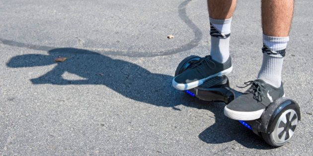 Logan Meis, 20, balances on his hover board outside his apartment complex in Overland Park, Kan., on...