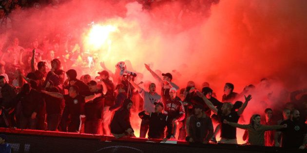 GOSFORD, AUSTRALIA - APRIL 11: Western Sydney wanderers fans let off flares during the round 25 A-League...
