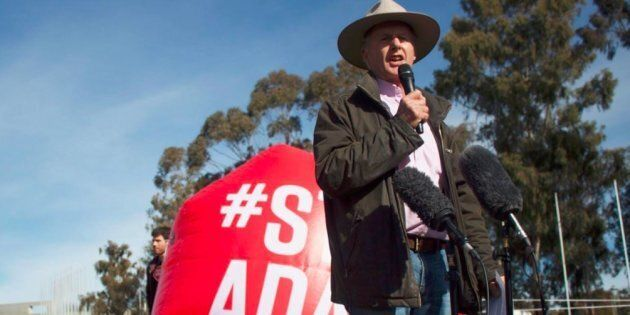 Sheep farmer, Charlie Prell speaks at the Stop Adani protest on the front lawns of Parliament House on