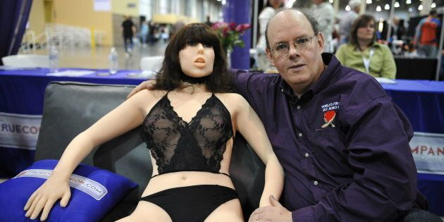 Engineer-inventor Douglas Hines poses with Roxxxy at the AVN Adult Entertainment Expo in Las Vegas,