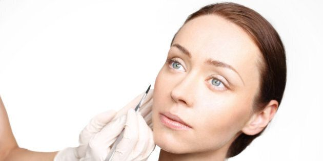 Plastic surgery, a woman in the clinic of aesthetic