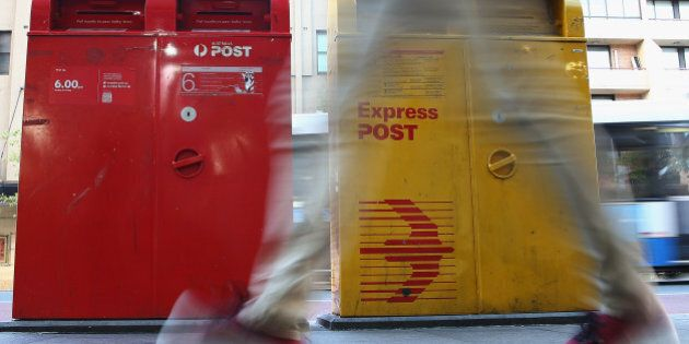 SYDNEY, AUSTRALIA - MAY 07: A man scuttles past a Post Office Box outside the Darlinghurst Post Office...