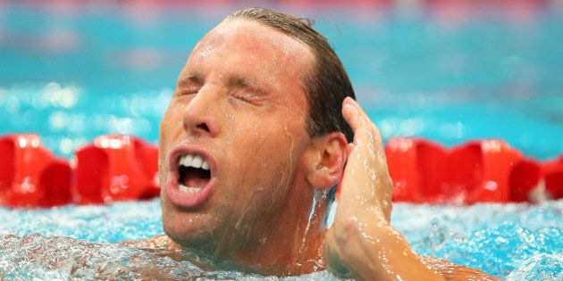 SYDNEY, AUSTRALIA - APRIL 05: Grant Hackett of Qld leaves the pool following the Men's 200m Freestyle...