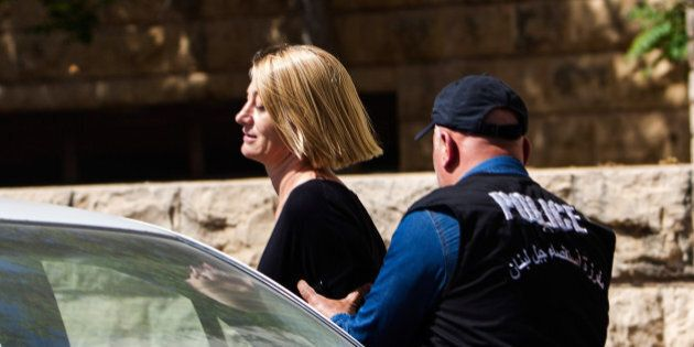 BEIRUT, LEBANON - APRIL 18: TV presenter Tara Brown is escorted from court on April 18, 2016 in Beirut,...