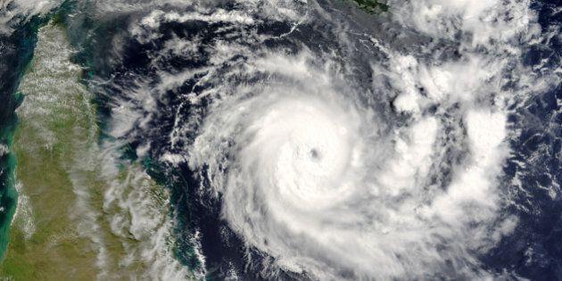 Terra satellite image of tropical cyclone Ingrid in Coral