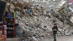 Activists: 36 Mass Graves Discovered In Syria's Deir