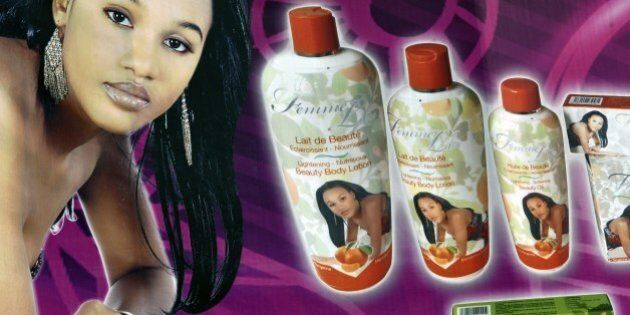 A picture taken on May 2, 2015 shows a giant advertising placard of skin-lightening products in Abidjan....