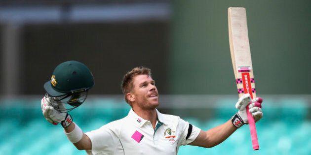 SYDNEY, AUSTRALIA - JANUARY 07: David Warner of Australia celebrates after reaching his century during...