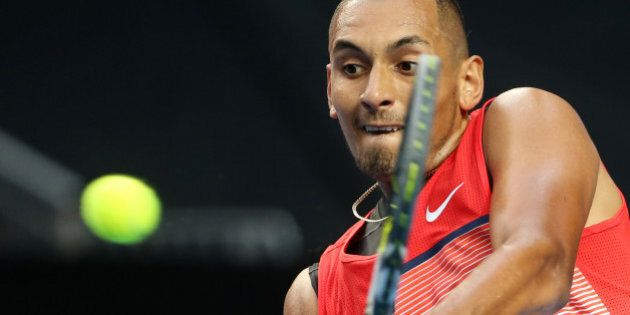 Nick Kyrgios of Australia makes a backhand return to Pablo Carreno Busta of Spain during their first...