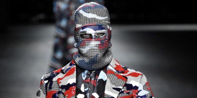 MILAN, ITALY - JANUARY 17: A model walks the runway at the Moncler Gamme Bleu show during Milan Men's...