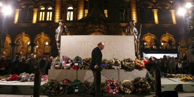A war veteran walks in front of the Cenotaph during the annual dawn service commemoration on ANZAC (Australian...