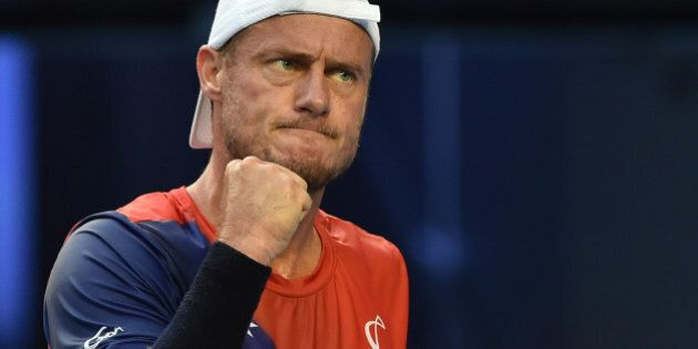 Australia's Lleyton Hewitt gestures during his men's singles match against Spain's David Ferrer on day...