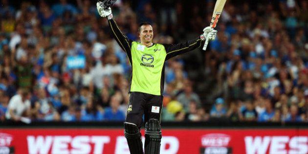 ADELAIDE, AUSTRALIA - JANUARY 21: Usman Khawaja of the Sydney Thunder celebrates reaching 100 runs during...