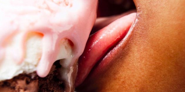 Boy eating ice cream. Most ice cream is high in fat and sugar, and consequently high in calories. Ice...