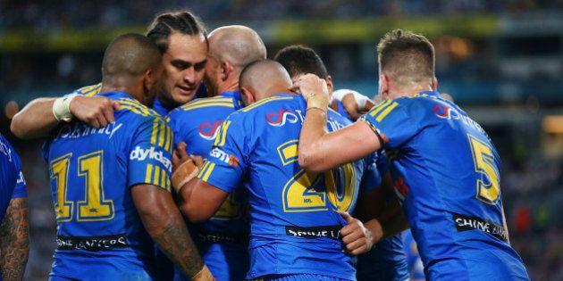 SYDNEY, AUSTRALIA - APRIL 29: Parramatta players celebrate a try by Vai Afu Toutai of the Eels during the round nine NRL match between the Parramatta Eels and the Canterbury Bulldogs at ANZ Stadium on April 29, 2016 in Sydney, Australia.  (Photo by Mark Nolan/Getty Images)