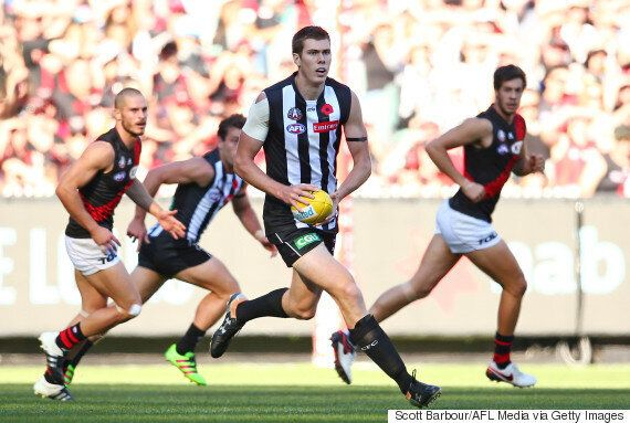 American Mason Cox Of The Collingwood Magpies Kicks Goal In His AFL