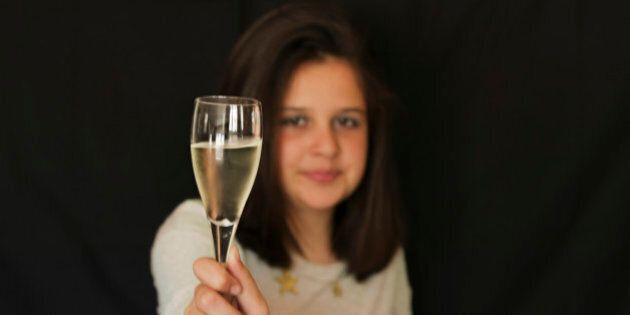Preteen girl toasting. Black