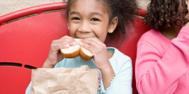 Girl eating lunch at recess