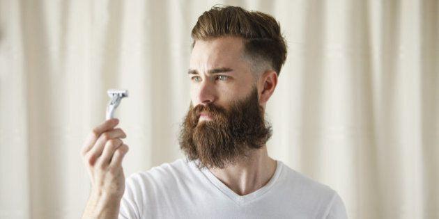Bearded Caucasian man examining