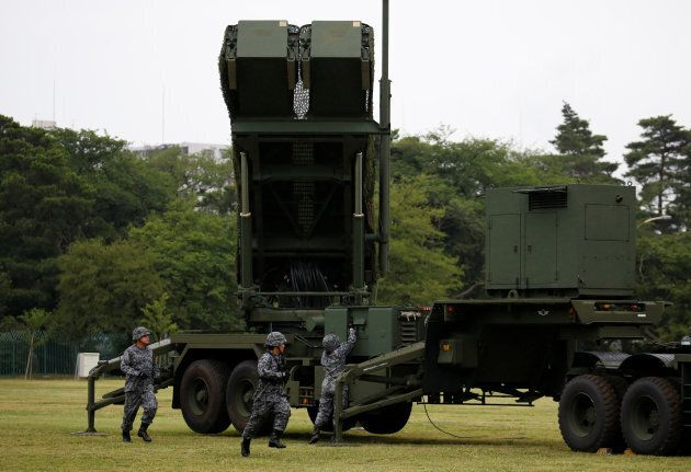 Japan Self-Defense Forces (JSDF) soldiers hold a drill to mobilise their Patriot Advanced Capability-3...