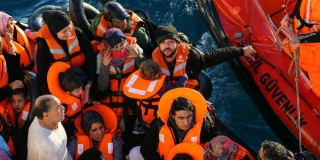IZMIR, TURKEY - JANUARY 20: Turkish Coast Guard members intervene in a boat carrying refugees, who were...
