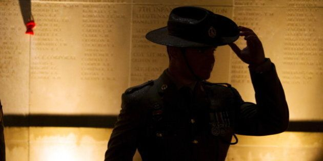 An Australian army soldier attends the dawn service to mark the 100th anniversary of ANZAC (Australian...