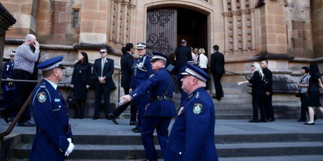 SYDNEY, AUSTRALIA - OCTOBER 17: People arrive for a funeral service for Curtis Cheng at St Mary's Cathedral...