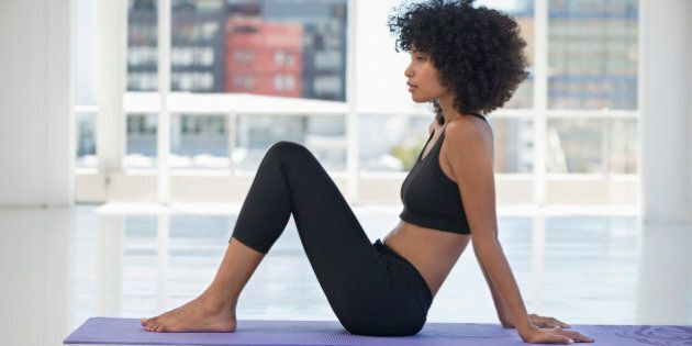 Woman practicing yoga on an exercise