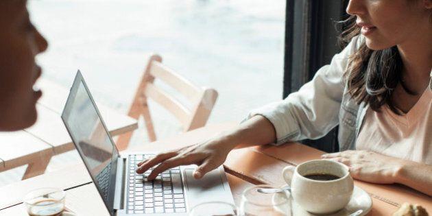Women using laptop computer in coffee