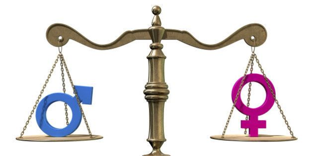A gold justice scale with the two different gender symbols on either side balancing each other out on...