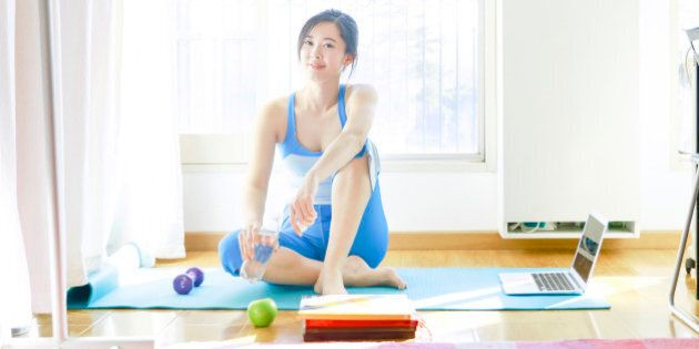 woman yoga alone with laptop at