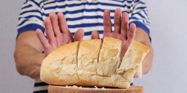 Gluten intolerance and diet concept. Man refuses to eat white bread. Selective focus on