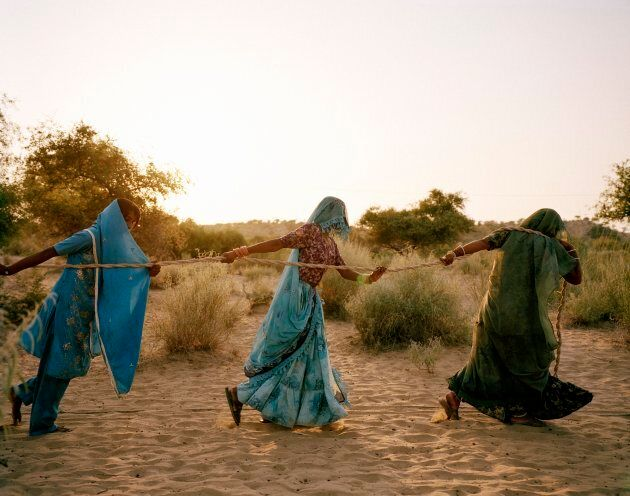 Women pull water from a well in the Thar Desert, where temperatures hover between 48°C and 50°C on summer days.