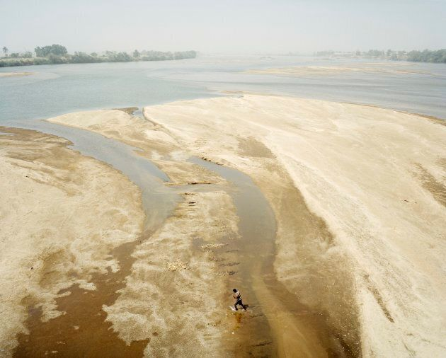 During the Hamattan, a relatively cold season characterised by dry winds and clouds of dust, the Benue River becomes almost completely dry.