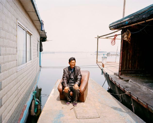 Wang's whole family has lived on boats on Lake Hong for generations. Since work began to restore the lake wetland reserve in 2002, Wang and his family have seen it transformed from being dirty and polluted through unsustainable fishing practices to the cleaner lake it is today.