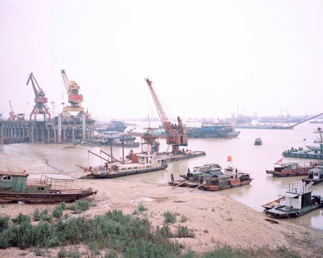 Large ships dominate the landscape of China's second-largest freshwater lake. The ships are used to transport sand and other industrial goods such as fertiliser.