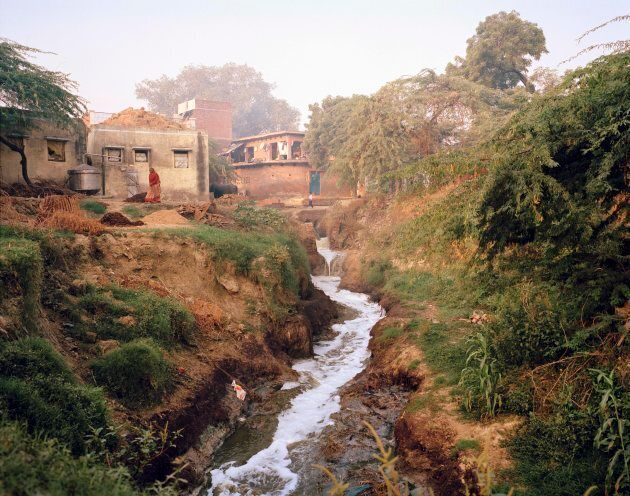 Water from the nearby sewage works, polluted with chemicals from tanneries, glue factories and poorly treated human waste, flows through Jana village on the banks of the Ganges