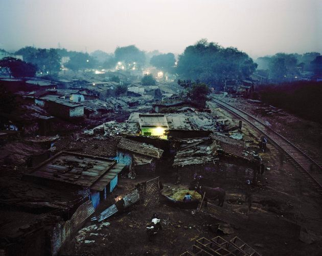 The Rakhi Mandi slum is located on a landfill site next to a busy railway line. Residents of informal settlements like this often lack the legal right to build permanent structures such as toilets, even if they have the means and ability to do so.