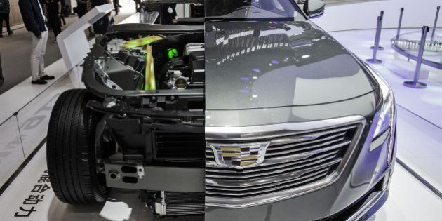 A cutaway display of a General Motors Co. Cadillac CT6 electric vehicle stands at the Beijing International...