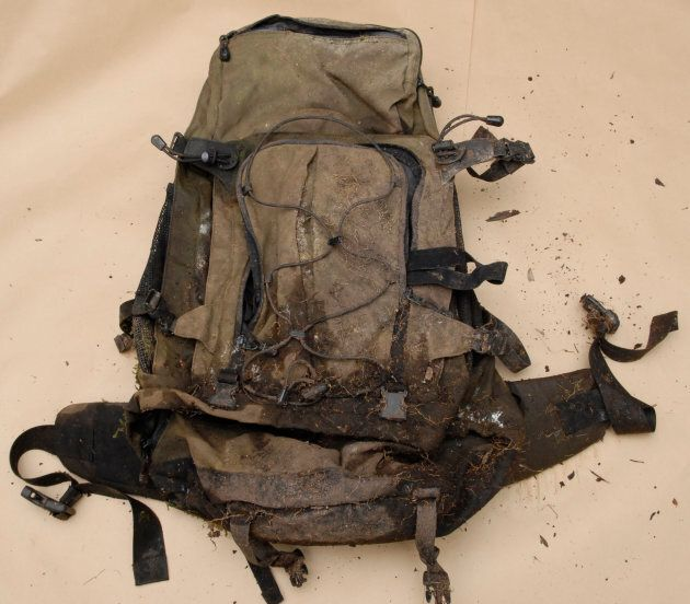 A backpack containing men's clothing, an SD card and Swiss and Hong Kong currency was found in the bush...