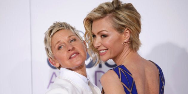 TV personality Ellen DeGeneres arrives with her spouse, actress Portia di Rossi (R), at the 2015 People's...